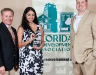 Lake Worth CRA accepting award from FRA
