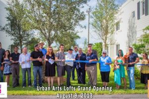 Image of ribbon cutting for Urban Arts Lofts August 9 2013