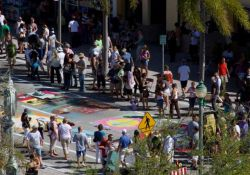 Aerial image of people looking at street artwork