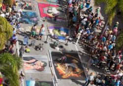 Aerial image of people viewing street artwork